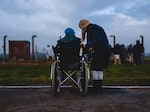 Person on a wheelchair talking to another person
