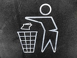 Man throwing rubbish in trash bin logo/symbol