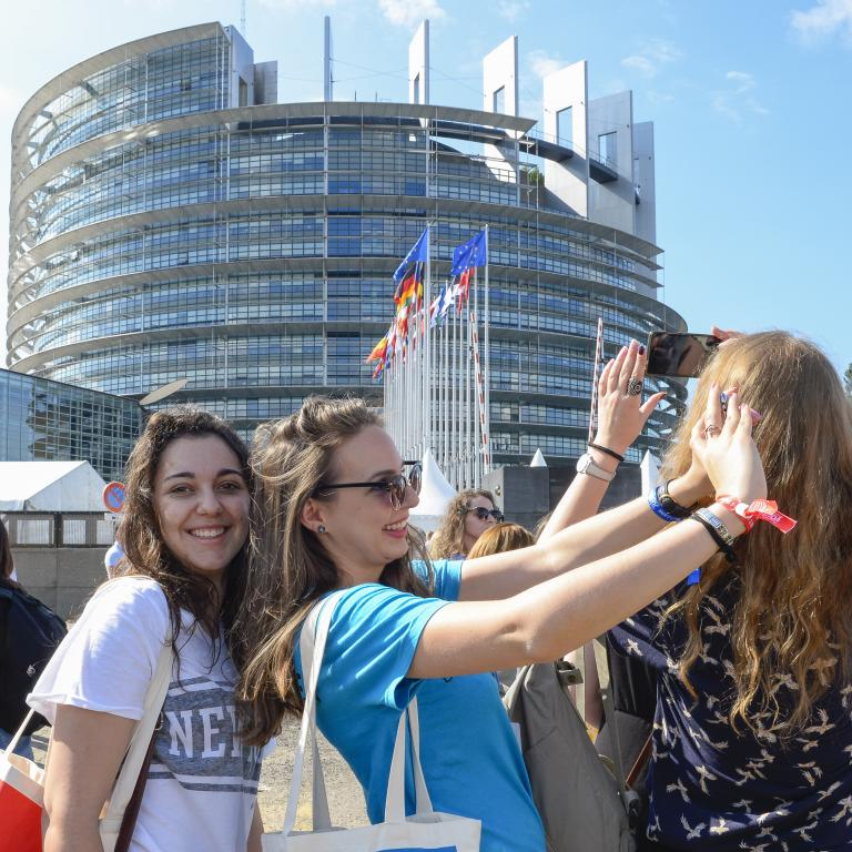 Girls taking a selfie in front of the building of European Parliament