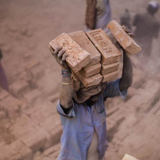 Black man holding bricks